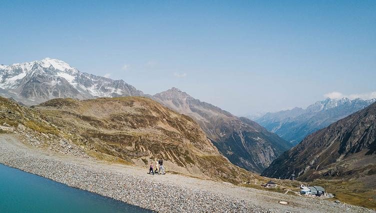 Family hiking in the mountains, Mutterbergersee Stubai Glacier