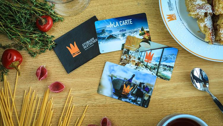 Four vouchers for the restaurants on the Stubai Glacier lying on a dining table